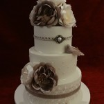 3 tier pearl lace and birds wedding cake