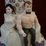 Handmade sugar bride and groom and hand painted brush embroidery