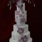 Brush Embroidered Wedding Cake with cascading Sugar Flowers