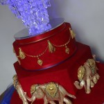 Asian elephants red and gold wedding cake