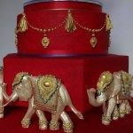 red and gold asian elephants wedding cake