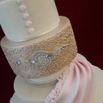 Roses Sugar Buttons and Ruffles Drape Diamante Pink Gold and Ivory Elegant Bride and Groom Wedding Cake